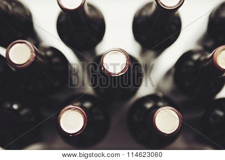 Glass bottles of wine on white background, close up