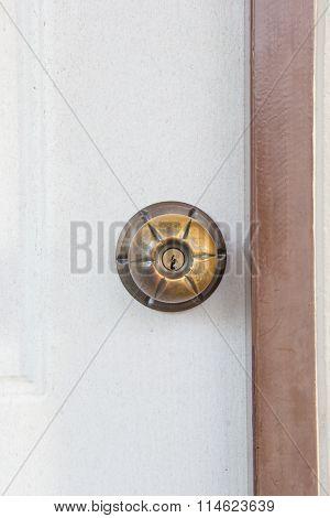 Brass door knob on the Cream door