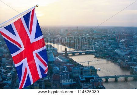 London at sunset aerial view and British flag. Illustration