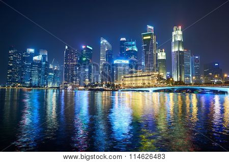 SINGAPORE - NOVEMBER 17, 2015: Singapore downtown at night. Singapore is a leading global city in Southeast Asia and the world's only island city-state.