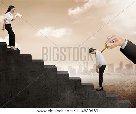 Business Woman Talk To Her Friend With Winding Key On Her Back