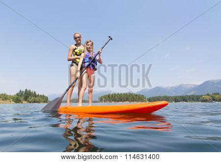 Paddleboarding on scenic mountain lake low angle view