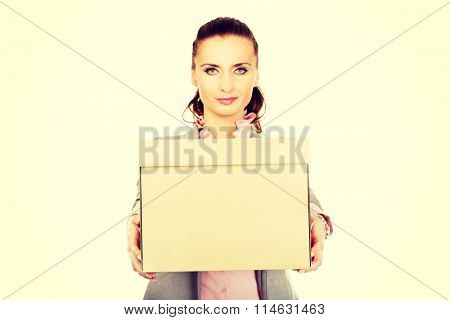 Sad businesswoman carrying box.