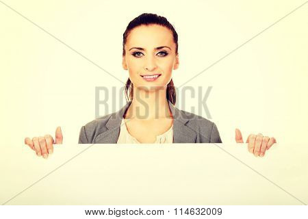 Business woman presenting empty banner.