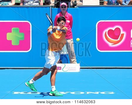 Hyeon Chung of South Korea focuses on a backhand