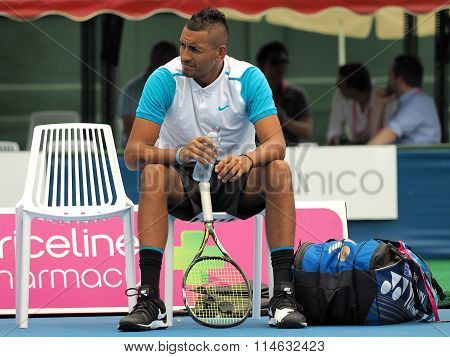 Nick Kyrgios waiting for a match to begin at Kooyong