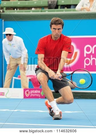 Gilles Simon of France with ball on racquet