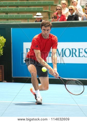 Gilles Simon of France hits a low backhand