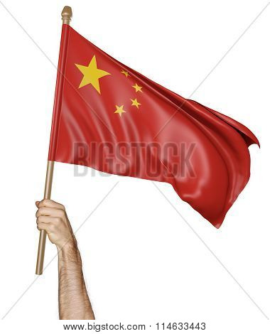 Hand proudly waving the national flag of China