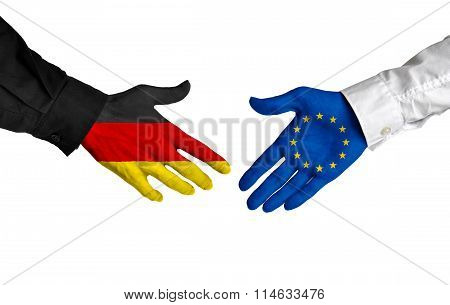 Germany and European Union leaders shaking hands on a deal agreement