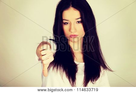 Unhappy woman with thumbs down.