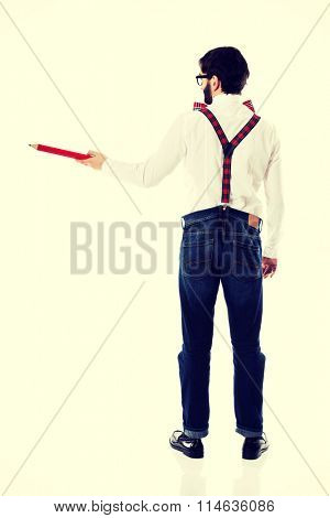 Old fashioned man pointing with big pencil.