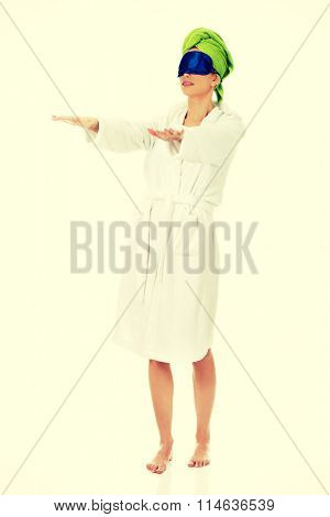 Sleepwalking woman in bathrobe.