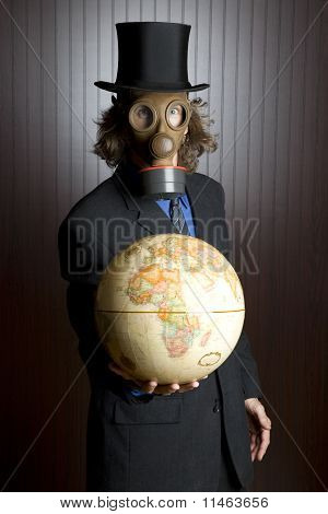 Man in a gas mask holding an earth globe