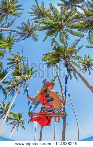 Mother With Baby Girl Fly High In Sky On Swing