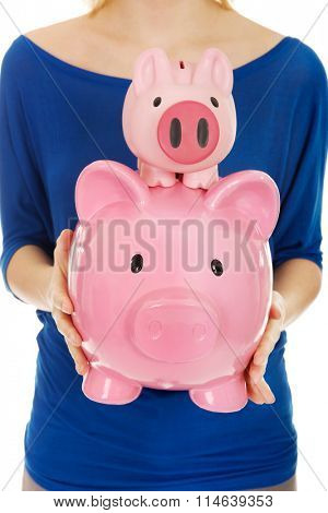 Woman with piggybanks.