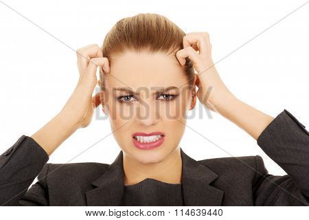 Frustrated business woman screaming.