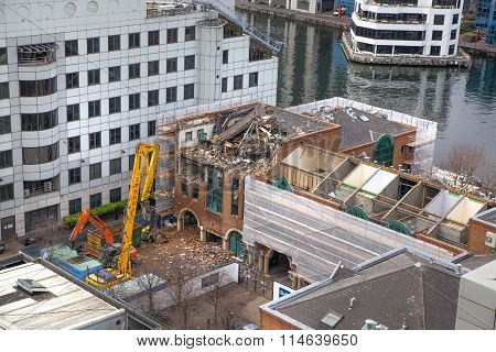 LONDON UK - APRIL 2, 2015: Demolition site in London. Cranes and excavators cleaning the site for ne