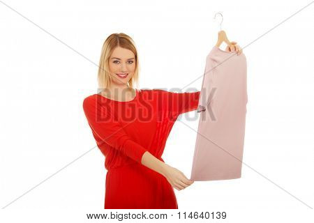 Woman thinking what to wear.