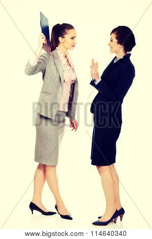 Businesswoman disagree with her friend idea.