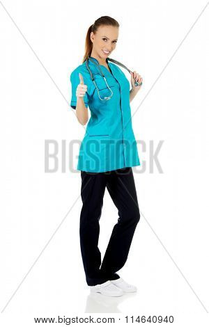 Woman doctor with thumbs up.
