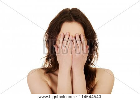Woman covering her face.