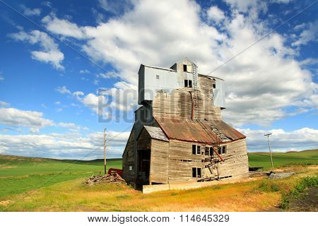 Old abandoned,wrecked barn in the fields