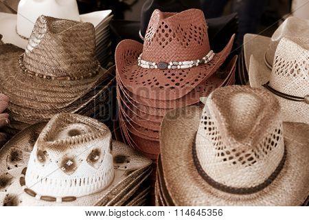 Close up shot of many cowboy hats
