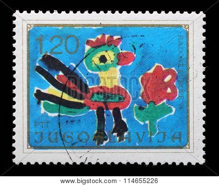 YUGOSLAVIA - CIRCA 1974: a stamp printed in Yugoslavia shows Rooster and Flower, Childrens Drawing, Joy of Europe issue, circa 1974.
