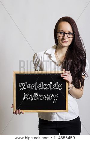 Worldwide Delivery - Young Businesswoman Holding Chalkboard