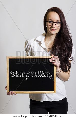 Storytelling - Young Businesswoman Holding Chalkboard