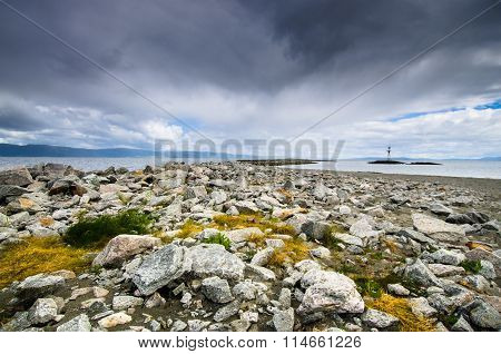 Beautiful landscape coastline of Munkholmen with dramatic cloudy sky, Trondheim, Norway