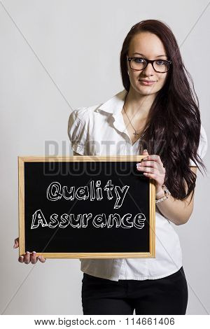 Quality Assurance - Young Businesswoman Holding Chalkboard