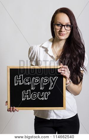 Happy Hour - Young Businesswoman Holding Chalkboard