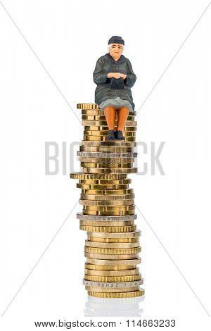 pensioner sitting on money stack