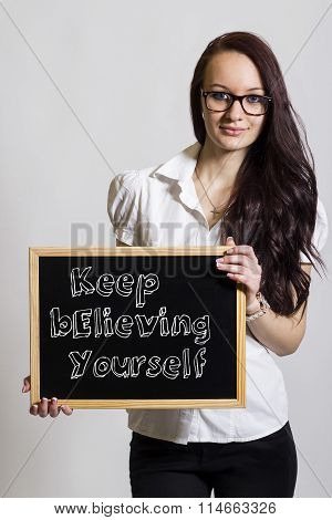 Keep Believing Yourself Key - Young Businesswoman Holding Chalkboard