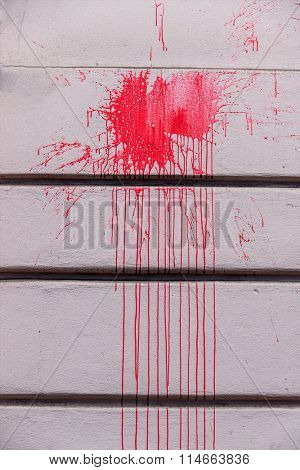 red ink splashes on a wall