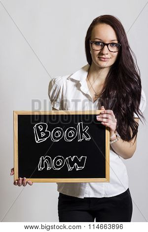 Book Now - Young Businesswoman Holding Chalkboard
