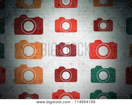 Travel concept: Photo Camera icons on Digital Paper background