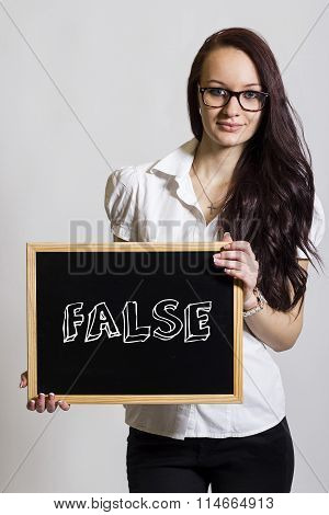 False - Young Businesswoman Holding Chalkboard