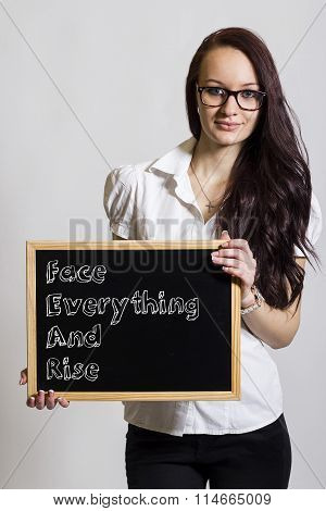 Face Everything And Rise Fear - Young Businesswoman Holding Chalkboard