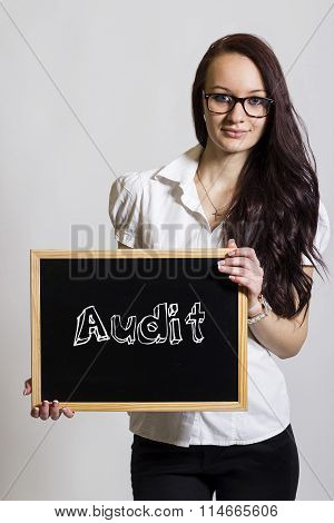 Audit - Young Businesswoman Holding Chalkboard