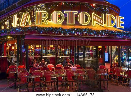 The La Rotonde Cafe In Evening,  Paris, France.