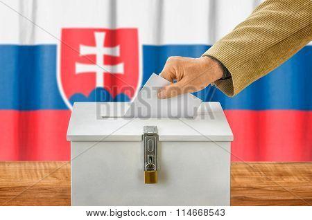Man Putting A Ballot Into A Voting Box - Slovakia