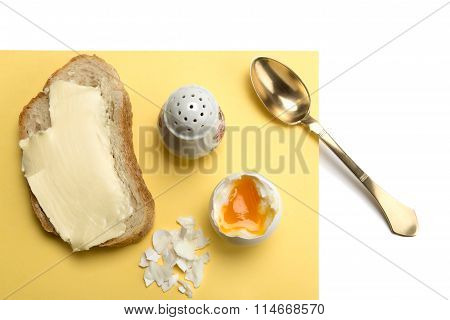 Boiled Egg, Bread With Butter, Salt Cellar And Brass Spoon