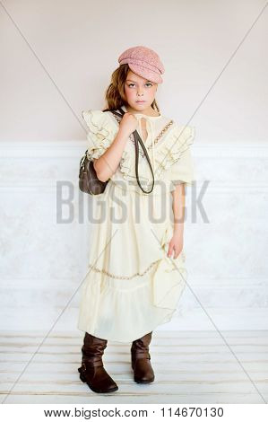 The Little Girl In A Beige Dress