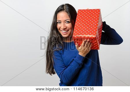 Excited Young Woman Holding A Red Gift