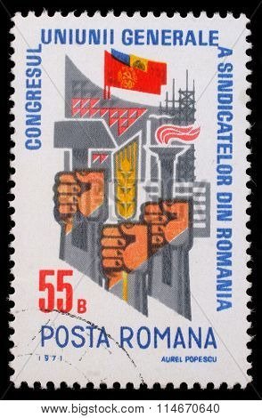 ROMANIA - CIRCA 1971: a stamp printed in Romania shows Trade Union Congress  Fists with hammer, ear and torch, circa 1971.