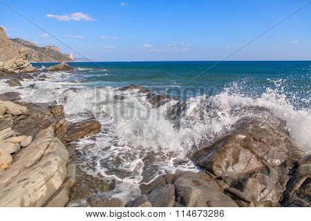 seawaves beating rocks