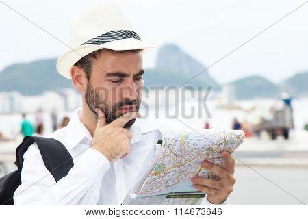 Thinking Tourist With Map At Rio De Janeiro